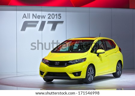 DETROIT - JANUARY 14 : The 2015 Honda Fit on display at the North American International Auto Show media preview  January 14, 2014 in Detroit, Michigan. - stock photo