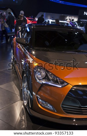 DETROIT - JANUARY 22: The 2013 Hyundai Veloster on display at the North American International Auto Show on January 22, 2011 in Detroit, Michigan. - stock photo