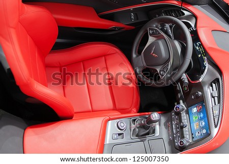 DETROIT - JANUARY 15 : The interior of the 2014 Corvette C7 Stingray at The North American International Auto Show  January 15, 2013 in Detroit, Michigan. - stock photo