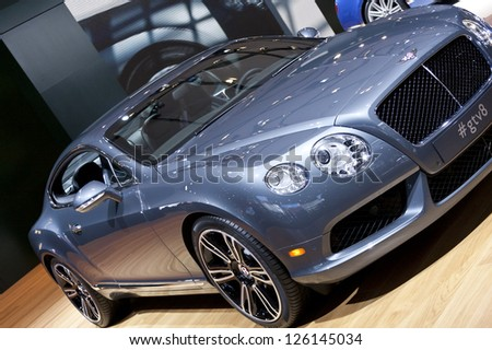DETROIT - JANUARY 27 :The new 2014 Bentley Continental GT V8 at The North American International Auto Show January 27, 2013 in Detroit, Michigan. - stock photo