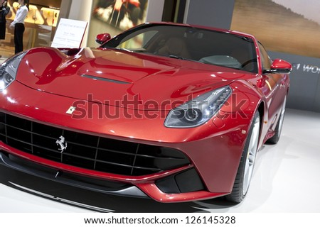 DETROIT - JANUARY 27 :The new 2013 Ferrari F12 Berlinetta at The North American International Auto Show January 27, 2013 in Detroit, Michigan. - stock photo