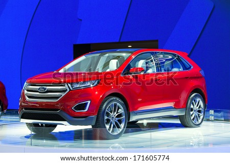 DETROIT - JANUARY 14 : The new Ford Edge concept on display at the North American International Auto Show media preview  January 14, 2014 in Detroit, Michigan. - stock photo