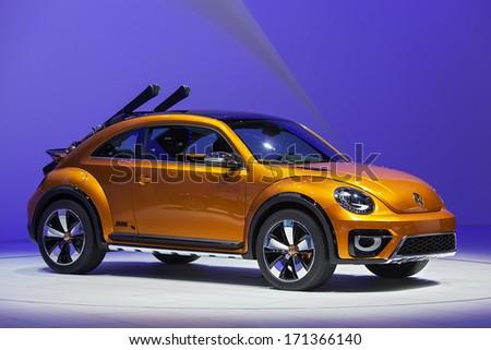 DETROIT - JANUARY 14 : The new Volkswagen Dune Beetle concept on display at the North American International Auto Show media preview  January 14, 2014 in Detroit, Michigan. - stock photo