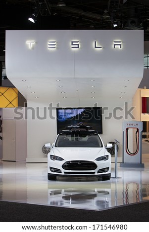 DETROIT - JANUARY 14 : The Tesla Model S on display at the North American International Auto Show media preview  January 14, 2014 in Detroit, Michigan. - stock photo