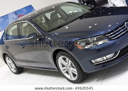 DETROIT - JANUARY 23:  VW Passat on display at the North American International Auto Show on January 23, 2011 in Detroit, Michigan. - stock photo