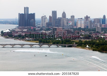 DETROIT - JULY 13: Aerial view of downtown Detroit at the APBA Gold Cup July 13, 2014 on the Detroit River in Detroit, Michigan. - stock photo
