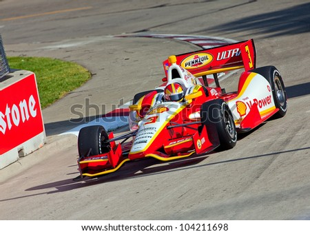 DETROIT - JUNE 2:The Shell V-Power Indy car comes around a corner at the 2012 Detroit Grand Prix on June 2, 2012 in Detroit, Michigan. - stock photo
