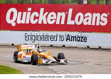 DETROIT - JUNE 2: The Sun Drop Indy car comes around a corner at the 2012 Detroit Grand Prix on June 2, 2012 in Detroit, Michigan. - stock photo