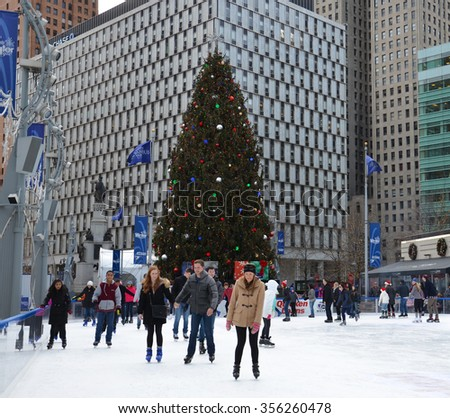 DETROIT, MI - DECEMBER 24: People skate in the rink at Campus Martius park in downtown Detroit, MI, on December 24, 2015.  - stock photo