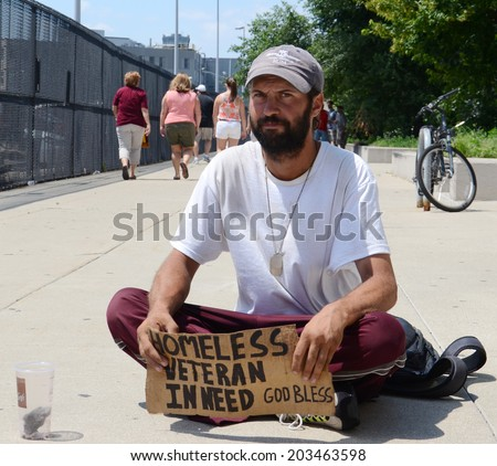 DETROIT, MI - JULY 6: Homeless veteran begs for money in Detroit, MI on July 6, 2014 - stock photo