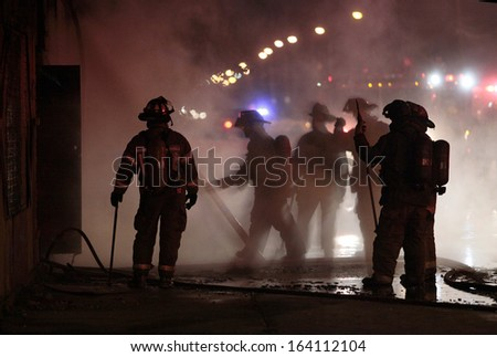 DETROIT, MI - SEPTEMBER 28 2012 - Firefighters tackle a commercial building fire at John R Street and Seven Mile Road.