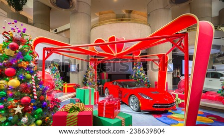 DETROIT, MI/USA - DECEMBER 18: A 2014 Chevrolet (Chevy) Corvette, presents, Christmas trees, and ornaments on public display at the GM (General Motors) Renaissance Center building. - stock photo