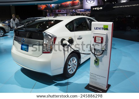 DETROIT, MI, USA - JANUARY 12, 2015: Toyota Prius and the Leviton charging station on display during the 2015 Detroit International Auto Show at the COBO Center in downtown Detroit. - stock photo