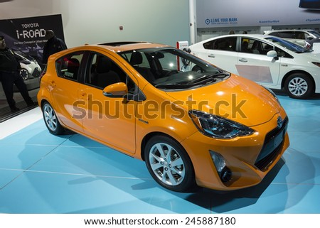 DETROIT, MI, USA - JANUARY 12, 2015: Toyota Prius c on display during the 2015 Detroit International Auto Show at the COBO Center in downtown Detroit. - stock photo