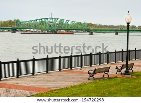 Detroit river down stream bridge to island park - stock photo