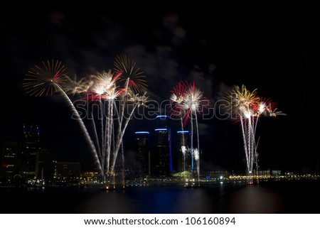 Detroit's Target Fireworks June 25th 2012 on the Detroit River celebrating the 4th of July. The skyline of Detroit and the Renaissance Center are seen behind the fireworks. - stock photo