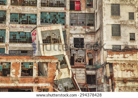 DETROIT, USA - JUNE 12, 2015: A collapsed tower, broken windows, and graffiti at the old Fisher Body Works factory highlight the post-industrial urban decay in Detroit. The factory was closed in 1984. - stock photo