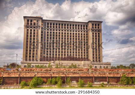 DETROIT, USA - JUNE 9, 2015: Michigan Central Station was the main intercity passenger rail depot for Detroit until the historic landmark was closed. This view from the back shows the railway tracks. - stock photo