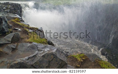 Dettifoss waterfall is the most powerful in Europe, Its width is 100 meters and the height of 44 meters - Iceland - stock photo