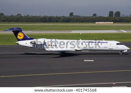 DEUTSCHLAND, GERMANY - September 22,2010: Lufthansa Regional (Lufthansa CityLine) Bombardier CRJ-701ER  (Registration:D-ACPB) taxied to RWY23L at Duesseldorf International Airport (DUS).