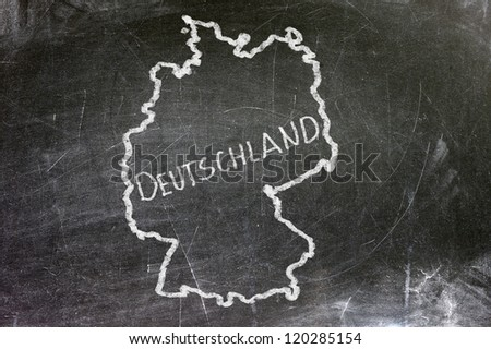 Deutschland map on a black plate. Map drawn with white chalk.