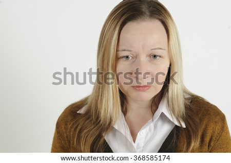 Devastated woman deep in her sad thoughts - stock photo