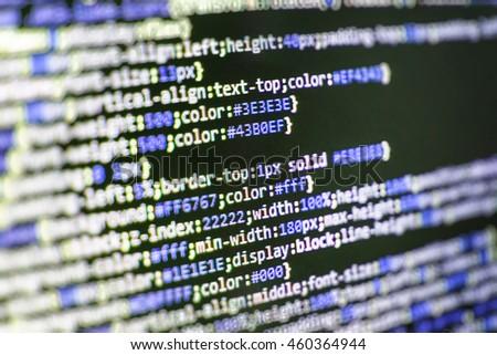 Developer working on websites codes in office. Software source code. Website development. Website programming code. Programming code. Developer working on software codes in office.   - stock photo