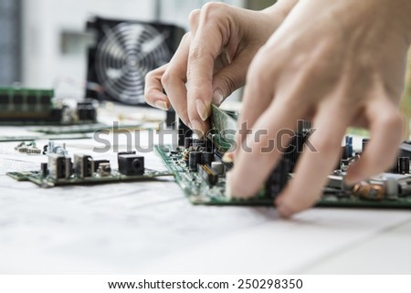 Developers who have a personal computer parts - stock photo