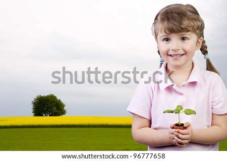 Development, growth concept - lovely girl with seedling - stock photo