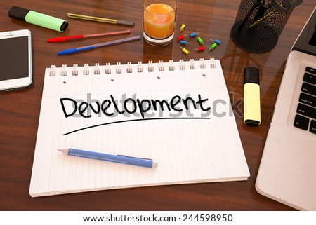Development - handwritten text in a notebook on a desk - 3d render illustration. - stock photo