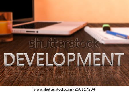 Development - letters on wooden desk with laptop computer and a notebook. 3d render illustration. - stock photo