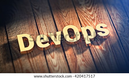 "Development operations. The word ""DevOps"" is lined with gold letters on wooden planks. 3D illustration image"