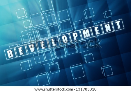 development - text in 3d blue glass cubes with white letters, business concept