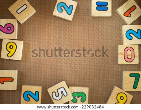 Developmental toys to put on a piece of wood - stock photo