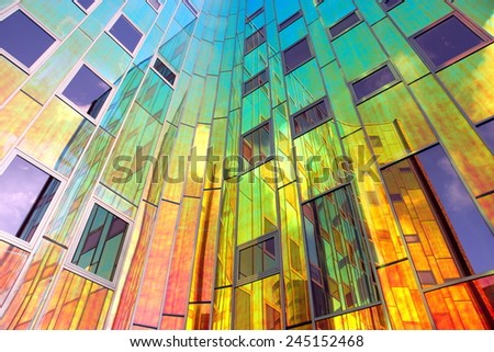 DEVENTER,NETHER LAND, December 19:Office building Larc en Ciel on Dec.19, 2014  Deventer,Netherlands .When the sun shines on the glass it turns into different colors  what gives a spectacular result  - stock photo