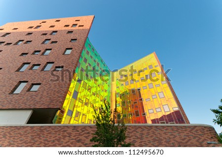 DEVENTER, NETHERLANDS - JUNE 26: Facade of the office building L'arc-en Ciel on June 26, 2012 in Deventer, Netherlands. Deventer is the 5th oldest city in the Netherlands with almost 100,000 residents - stock photo