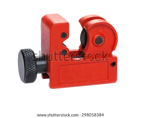 Device for cutting thin tubes on white background, closeup, shallow DOF - stock photo