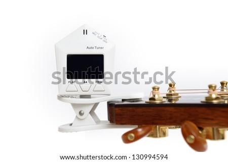 Device for Guitar Tuning by cliping - stock photo