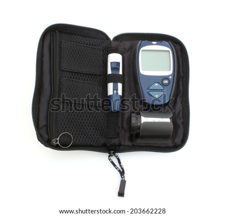 Device to check blood sugar levels and bag - stock photo