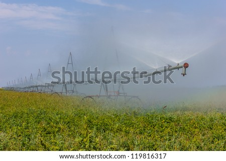 Device to water the fields on the background space