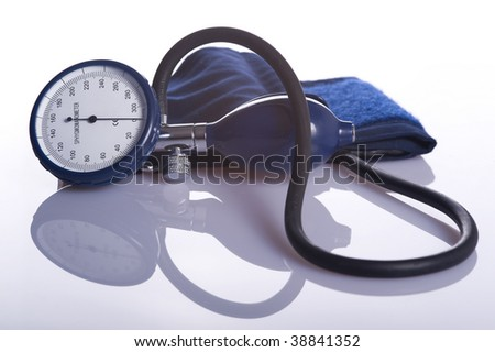 device used to measure blood pressure isolated on white background - stock photo