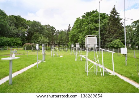 Devices for measuring wind speed, rainfall at weather station at summer day. - stock photo