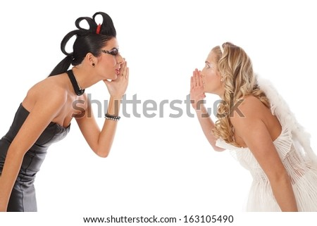 Devil and angel whispering to somebody's ears. - stock photo