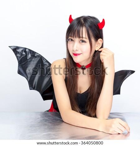 devil girl Halloween woman sexy glamour - stock photo