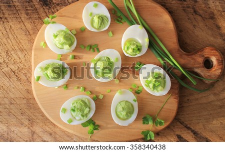 deviled eggs appetizer with avocado - stock photo