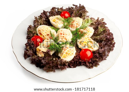 deviled eggs with mayonnaise on red salad leaves composition - stock photo