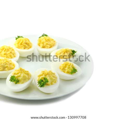 Deviled eggs with parsley in a plate - stock photo