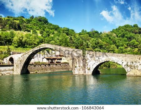 Devils Bridge in Lucca, Ponte del Diavolo during Spring Season, Italy - stock photo