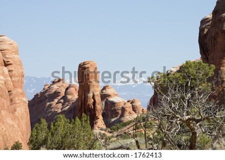 Devils Garden on Arches National Park with mountains on back, Utah, USA - stock photo