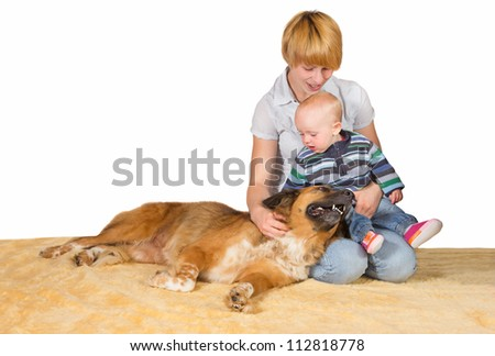 Devoted Mum, small baby and family dog sitting on the floor close together sharing a moment of love and tenderness with copyspace - stock photo